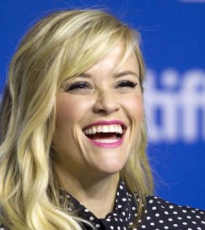 """Actress Reese Witherspoon attends a news conference to promote the film """"The Good Lie"""" at the Toronto International Film Festival in Toronto"""
