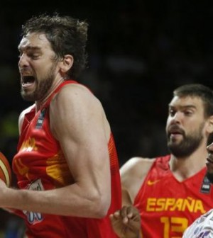 Spain's Pau Gasol challenges for a rebound with France's Boris Diaw during their Basketball World Cup quarter-final game in Madrid