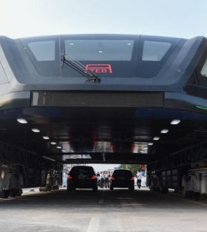 China's revolutionary elevated bus takes its first ride - Video