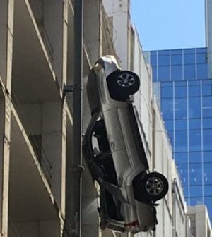 Driver escapes from car dangling off ninth-floor car park (Watch)
