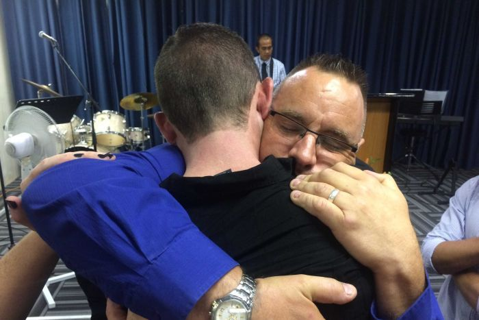 Father hugs driver accused of Christmas Day crash that killed his son