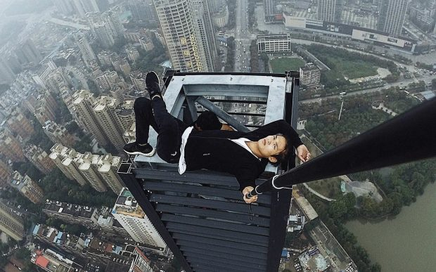 Chinese daredevil falls to his death while performing skyscraper stunt