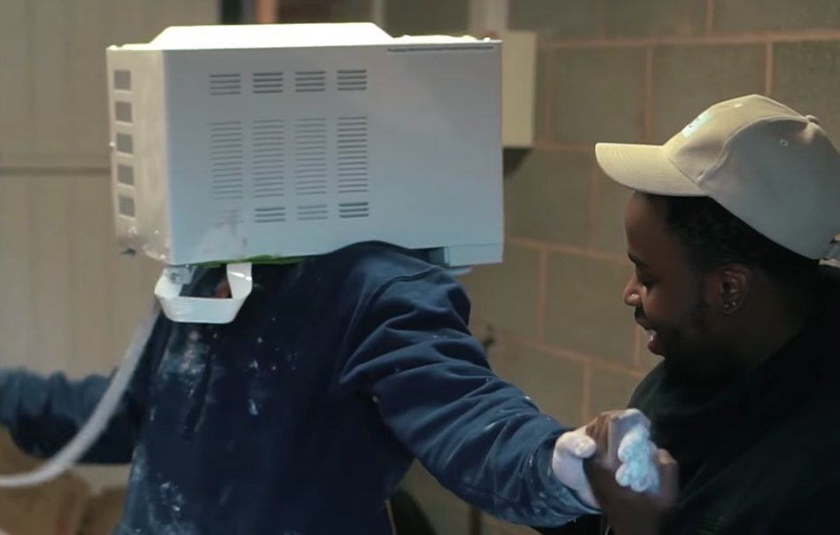 YouTube prankster 'cements' head inside microwave (Video)