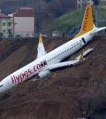 Plane skids off runway, gets stuck on cliff (Watch)