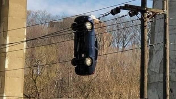 Mystery Car Hanging from Toronto bridge