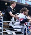 Giants fan, Saints fan - PHoto: Saints Fan Helps Disabled Giants Fan Stand
