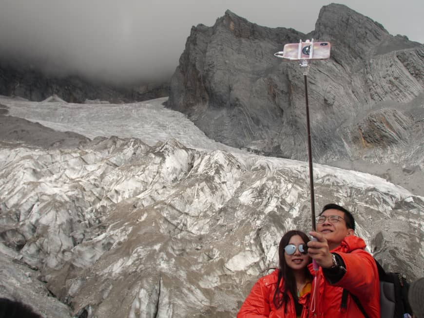 Melting Baishui glacier in China draws millions of tourists and scientists' fears